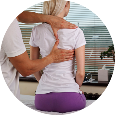 A chiropractor examining a lady in back pain at Light Touch Rehabilitation Center Bloomfield NJ