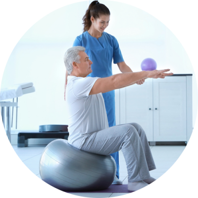 A senior citizen getting physical therapy from a female specialist at De La Torre Chiropractic Center in Totowa NJ