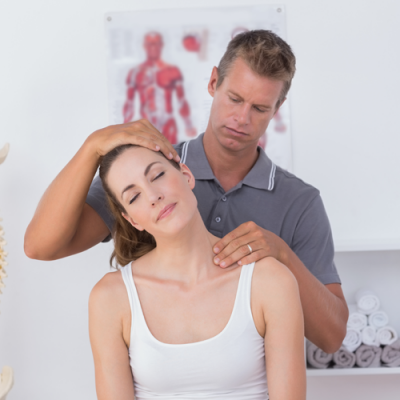An expert chiropractor during the checkup of a lady having neck pain at Sun Up Healthcare Jersey City NJ