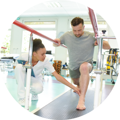 Female trainer helping the patient during a personal training session at Kinetic Physical Therapy Center Park Ridge NJ