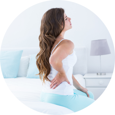 Lady in back pain due to auto injury thinking for the treatment at Light Touch Rehabilitation Center Bloomfield NJ